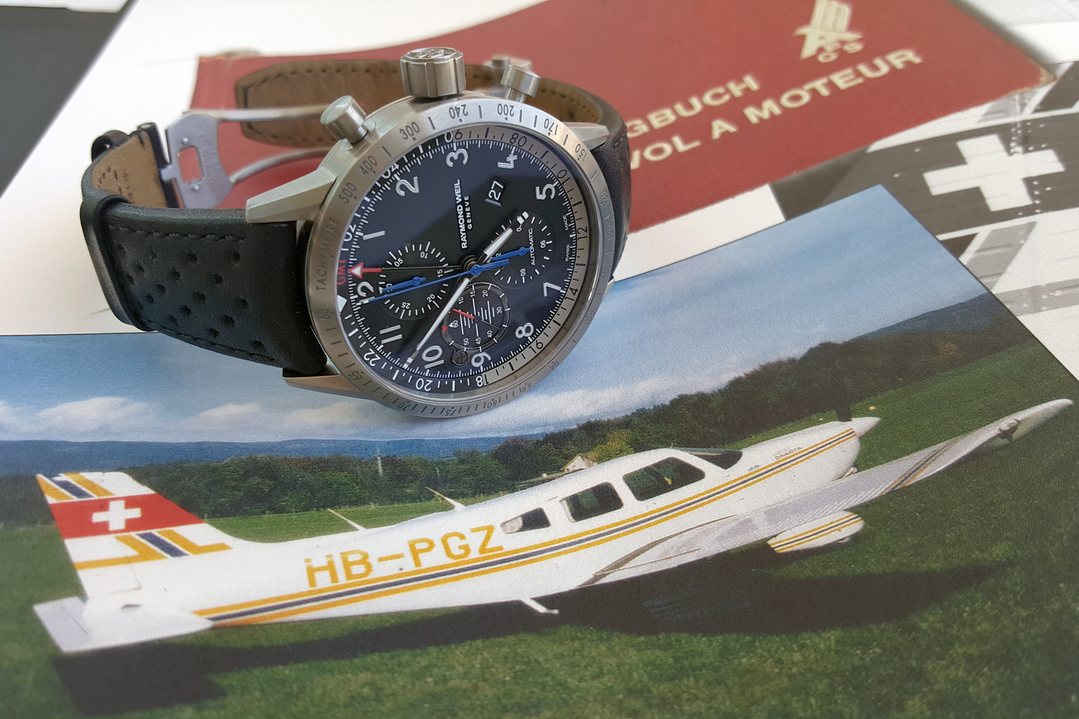 The new Freelancer Piper chronograph with a photograph of the plane that inspired its creation.