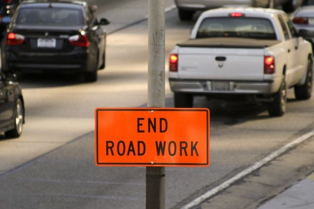"""""""end road work"""" sign displayed on the Harbor Freeway in Los Angeles, California"""
