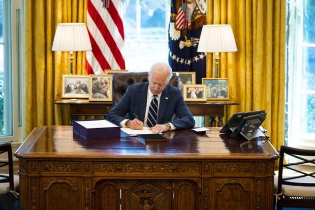 U.S. President Joe Biden signing the American Rescue Plan in the Oval Office of the White House in Washington, D.C., U.S.