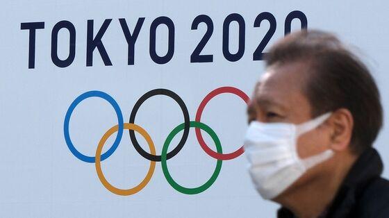 Japan's Suga Accepts Fan-Free Olympics in Bid to Control Virus