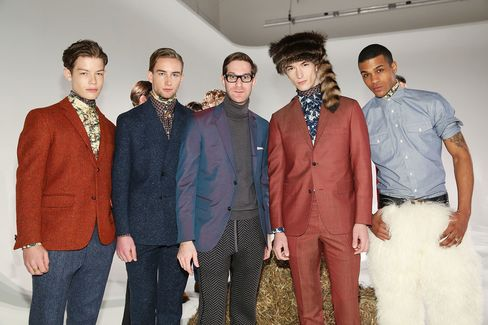Fashion designer David Hart (center) poses with models at the David Hart presentation during Mercedes-Benz Fashion Week Fall 2015 at Industria Studios on Feb. 11, 2015, in New York City. That event was sponsored by Cadillac.