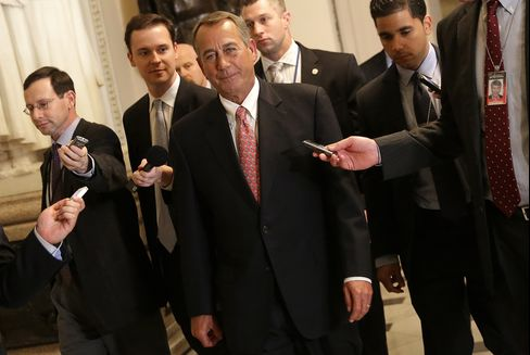 U.S. House Speaker John Boehner returns to his office after the House passed a $1.1 trillion spending bill after a day of disarray and just hours before U.S. government funding runs out.