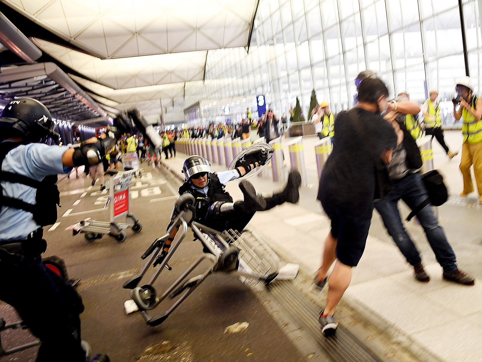 Police scuffle with demonstrators at Hong Kong's International Airport on Aug. 13.