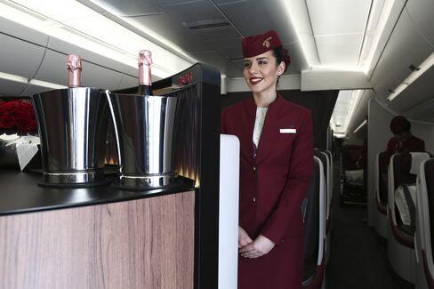 Champagne service for premium passengers on Qatar Airways