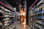 Products burn at a Carrefour supermarket in Sao Paulo, on Nov. 20.
