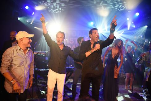 Ron Perelman, Don Johnson, Lionel Richie and Ciara on stage at Perelman's home, the Creeks in Wainscott, New York