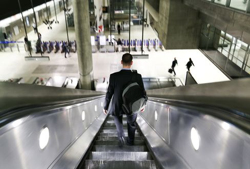 Commuters at Canary Wharf tube station