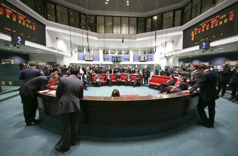 Traders Work On The Floor Of The London Metal Exchange