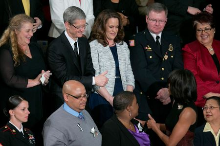 Tim Cook gestures to U.S. First Lady Michelle Obama before President Obama delivers the State of the Union address to a joint session of Congress in Washington, D.C. on Feb. 12, 2013.