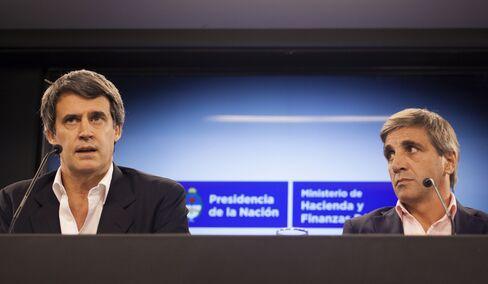 Alfonso Prat-Gay, left, and Luis Caputo.