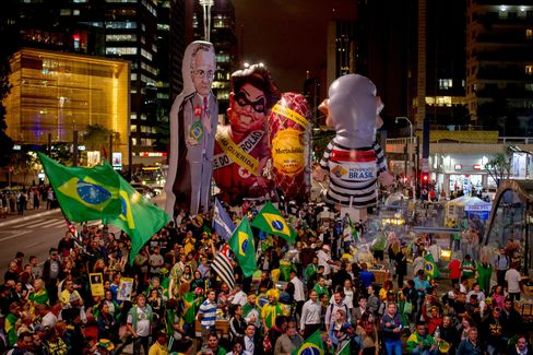 Demonstrators carry giant dummies that represent Brazilian President Dilma Rousseff and Brazilian former President Luiz Inacio Lula da Silva during a protest against the Brazilian government in Sao Paulo on Wednesday night.