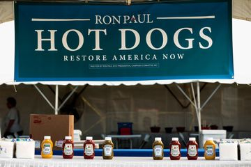 Representative Ron Paul's campaign set up a tent for free hot dogs outside the Hilton Coliseum at Iowa State University in Ames, where people were preparing to vote in the Iowa Straw Poll on Aug. 13, 2011.