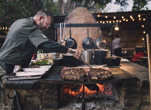Drew Deckman in his open kitchen.
