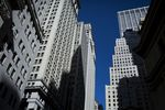 Buildings stand on Wall Street near the New York Stock Exchange (NYSE) in New York, U.S., on Monday, Feb. 22, 2016. Stocks retreated with government bonds, while the euro rallied to the highest level in almost a month as investors looked past an unprecedented boost from European monetary policy to focus on rising anxiety that policymakers have lost the ability to jumpstart global growth and stave off deflation.
