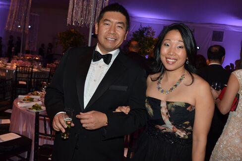Tom Cheung of Deutsche Bank and Stephanie Hsu, a consultant. Photographer: Amanda Gordon/Bloomberg