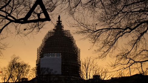 Scaffolding surrounds the U.S. Capitol Building Dome at sunset in Washington, D.C., U.S., on Tuesday, Dec. 9, 2014.