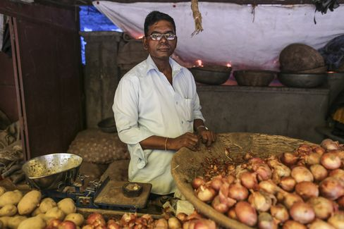 Anand Naik at his roadside onion and potato store