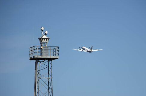 An airplane flies by a Saab's Remote Tower system in Ornskoldsvik, Sweden.