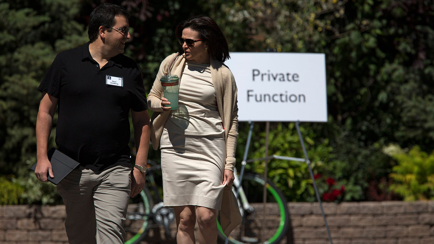 Goldberg walks with his wife, Sheryl Sandberg, chief operating officer of Facebook Inc., after a session at the Allen & Co. Media and Technology Conference in Sun Valley, Idaho, onJuly 12, 2013.