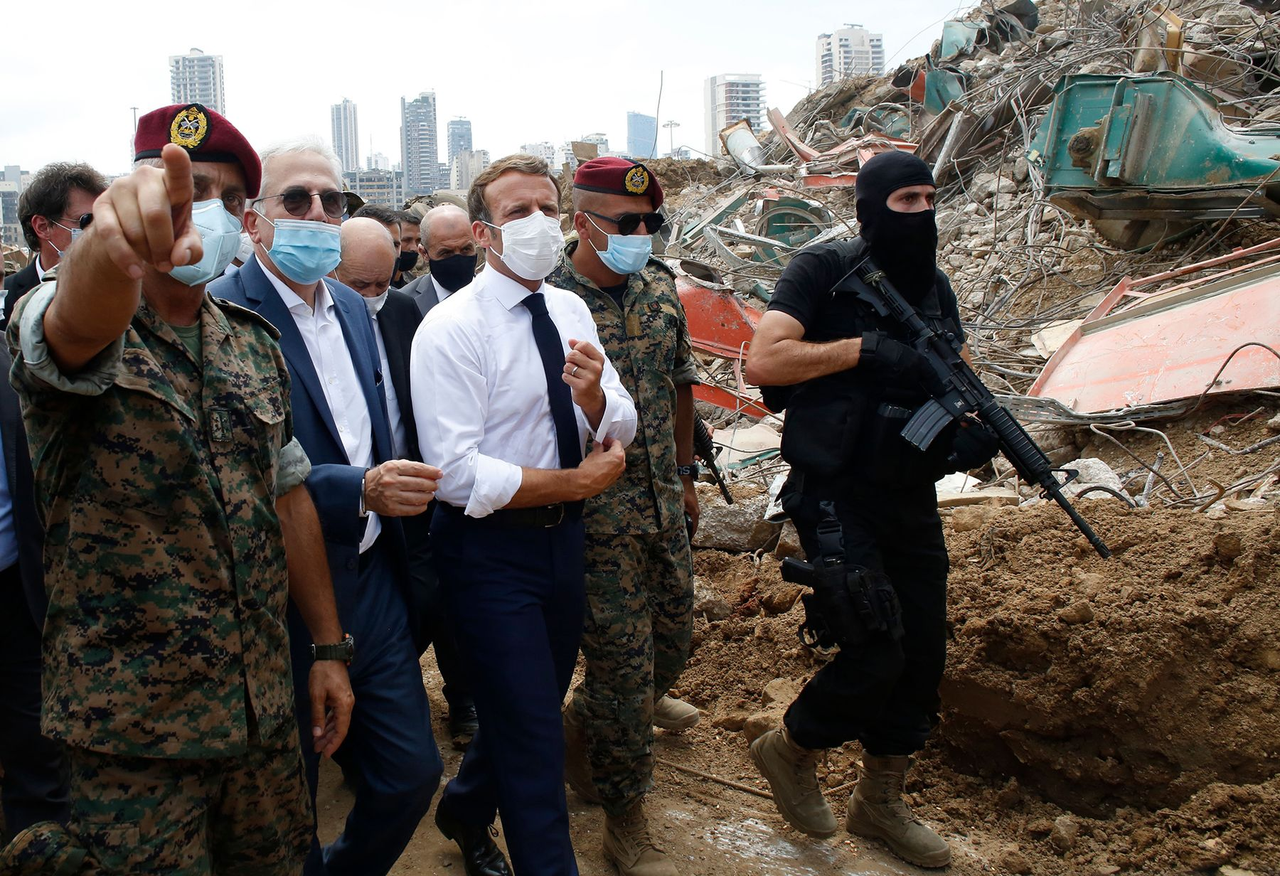 Emmanuel Macron visits the site of the explosion at the Port of Beirut, on Aug. 6.