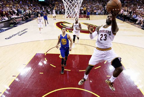 LeBron James of the Cleveland Cavaliers goes up against Stephen Curry of the Golden State Warriors.