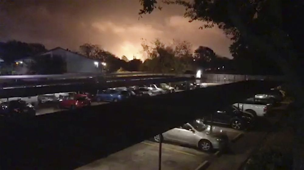 Smoke and fire fill the sky from a massive explosion at a Texas chemical plant in Port Neches onWednesday, Nov. 27.
