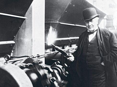 Thomas Edison lights a new boiler in West Orange, N.J., on Jan. 7, 1919.
