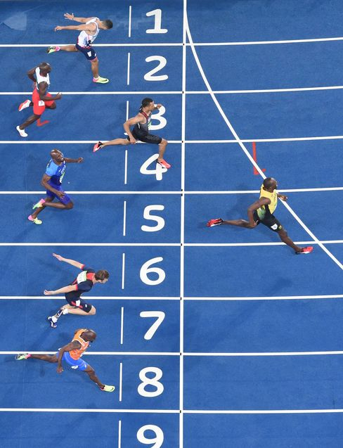 Jamaica's Usain Bolt crosses the finish line to win the Men's 200m Final.