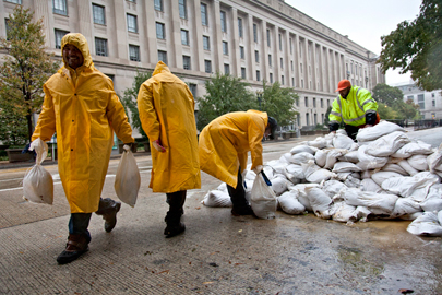 Workers haul sandbags to protect The Pavillion at the Old Post Office in Washington, D.C. on Oct. 29, 2012
