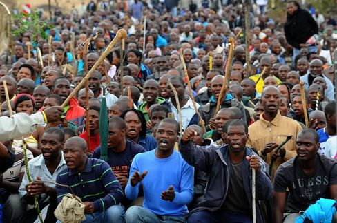 Striking Miners March In Marikana