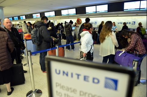 United Airlines Passengers Check in at Kennedy International