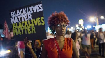 Demonstrators march to mark the first anniversary of the death of Michael Brown on Aug. 8, 2015, in Ferguson, Missouri.