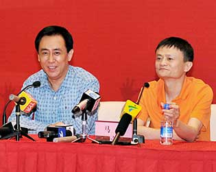 Jack Ma (right) and Evergrande Group Chairman Xu Jiayin attend a signing ceremony between Alibaba Group and Evergrande on June 5 in Guangzhou