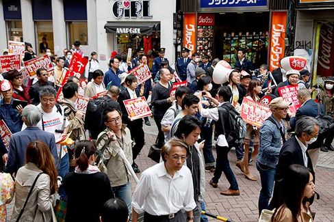 Fast-food workers protest for better payments and conditions around the Shibuya district in Tokyo on May 15
