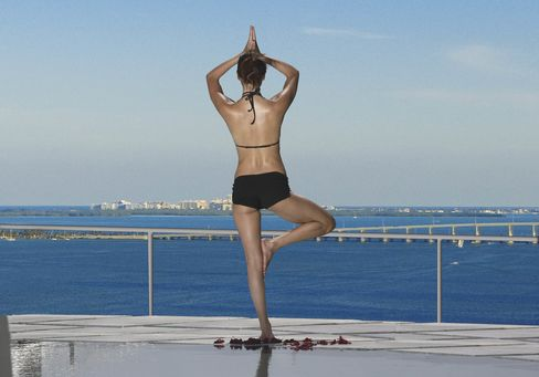 """Do yoga on your terrace—and have Kimpton provide """"roll-out"""" service."""
