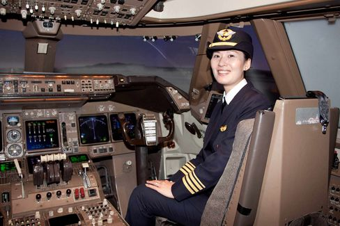 First Officer Sophia Kuo inside the cockpit of an EVA Airways Boeing 747.