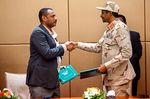 General Mohamed Hamdan Daglo andAhmed Rabie shake hands after signing the constitutional declarationinKhartoum on Aug. 4.