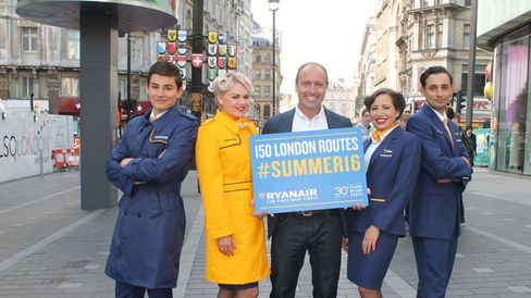 Ryanair's Chief Marketing Officer Kenny Jacobs, center, with cabin crew in London where the new creations were revealed. Source: Ryanair Holdings
