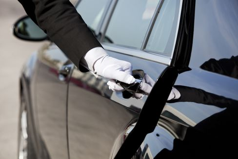 Chauffeur opening / closing luxury car door