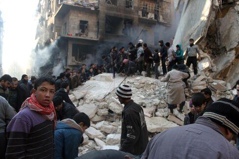 Syrians Search for Survivors in Aleppo