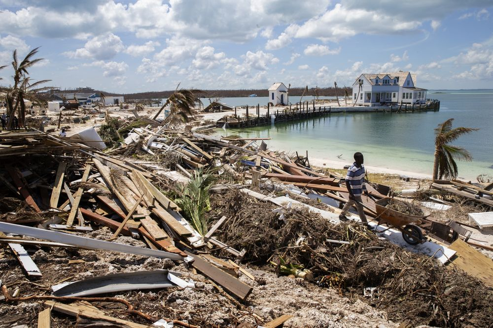 ELBOW KEY, BAHAMAS - SEPTEMBER 7: Workers clean debris at the Abaco Inn in Hurricane Dorian devastated Elbow Key Island on September 7, 2019 in Elbow Key Island, Bahamas.  The official death toll has risen to 43 and according to officials is likely to increase even more.  (Photo by Jose Jimenez/Getty Images)