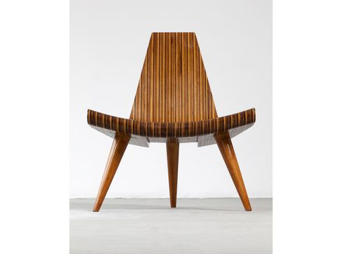 Three-legged chair in five different types of hard wood, with bonded laminated frame and solid, turned joints and legs. Designed by Joaquim Tenreiro, Brazil, c. 1947.
