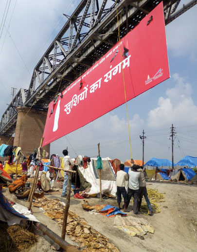 Coca-Cola signs hung from a bridge were seen by millions