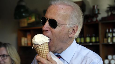 Vice President Joe Biden enjoys an ice cream cone after a campaign rally for Senator Jeff Merkley (not pictured) in Portland, Ore., on Oct. 8, 2014.