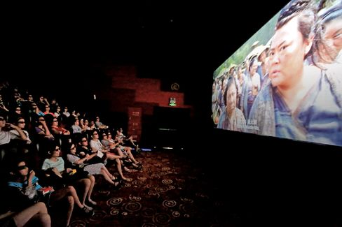 Chinese filmgoers wearing 3D glasses watch Monster Hunt in Shanghai on July 26.
