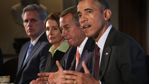 U.S. President Barack Obama (R) speaks as Speaker of the House Rep. John Boehner (R-OH) (3rd L), House Minority Leader Rep. Nancy Pelosi (D-CA) (2nd L), and House Majority Leader Rep. Kevin McCarthy (R-CA) (L) listen during a meeting in the Cabinet Room of the White House January 13, 2015 in Washington, DC.