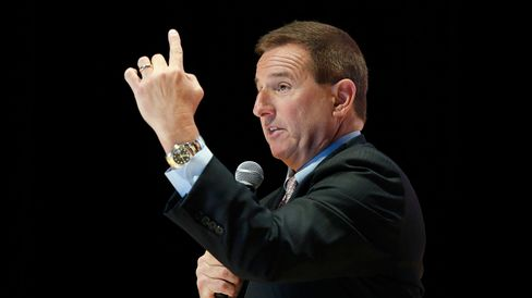 Mark Hurd, co-chief executive officer of Oracle, delivers a keynote speech at the Oracle CloudWorld 2015 conference in Tokyo on April 10, 2015.