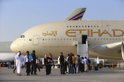 Visitor line up to access an Airbus A380-800 aircraft during the Dubai Air Show in 2015.