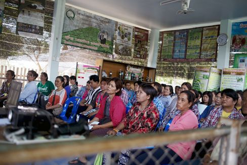 Thai rice farmers attend a government workshop training program