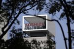Signage for Toshiba Corp. is displayed atop the company's headquarters in Tokyo, Japan.